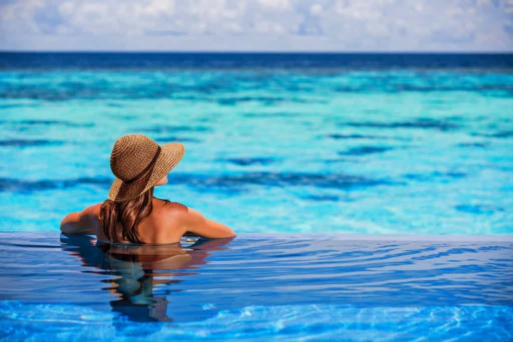 lady looking out from infinity pool