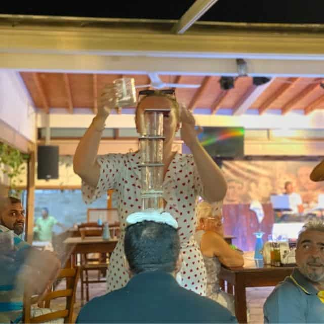 Lady put glass on mans head cyprus night